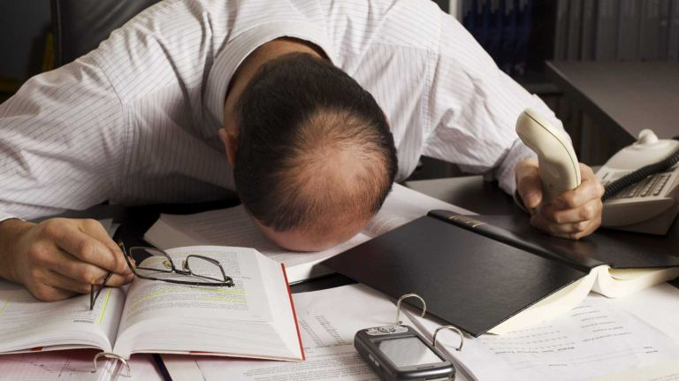 Business owner stressed while doing taxes